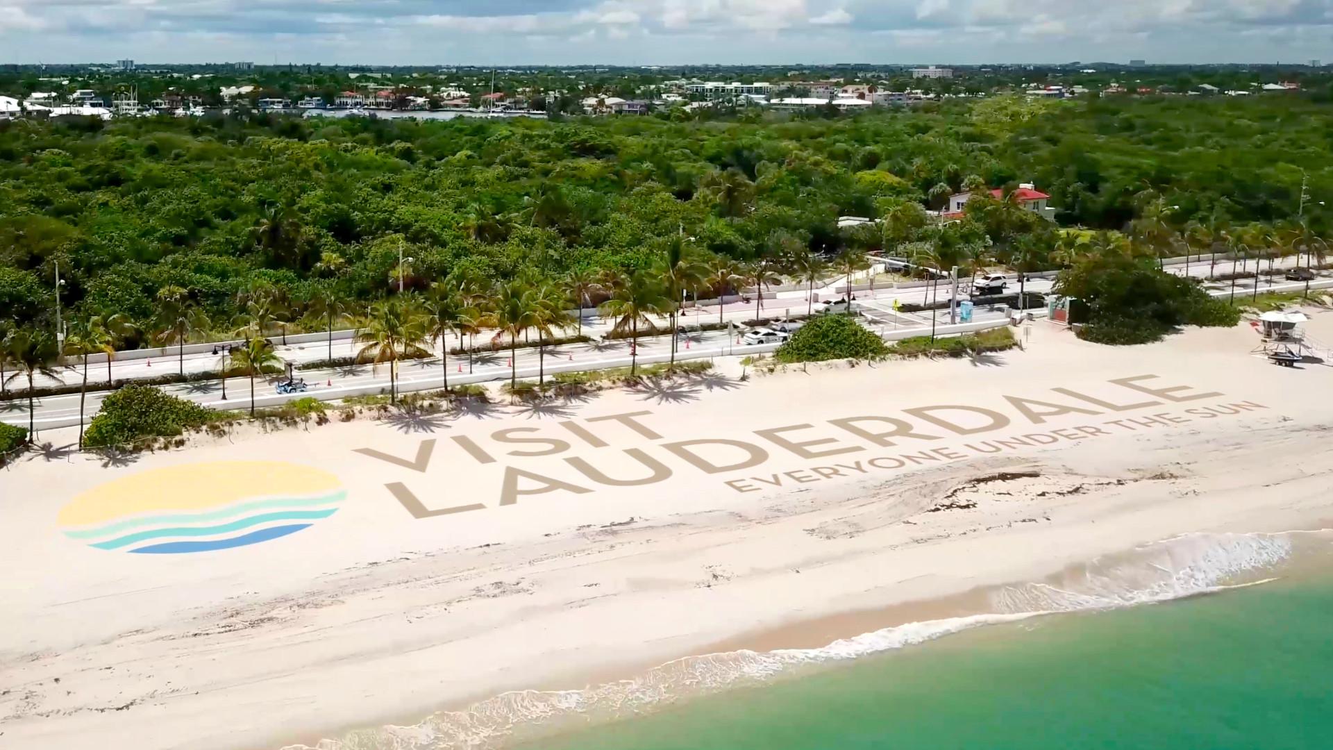 Visit Lauderdale, New Logo Everyone Under the Sun on Beach Sand
